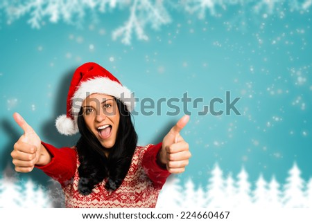 Woman giving a thumbs up against blurred fir tree background