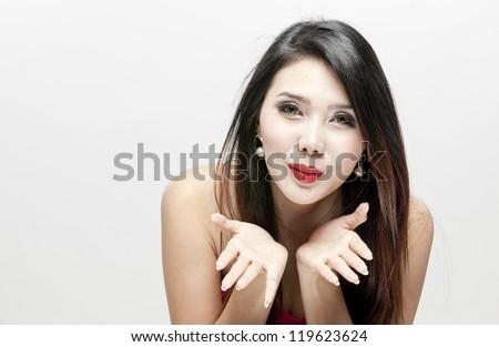 woman giving an air kiss - stock photo