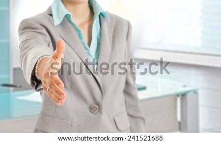 Woman giving an handshake. Selective focus on the hand - stock photo