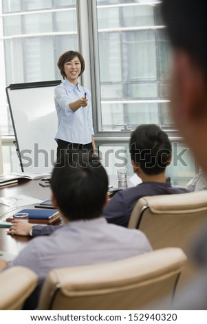Woman Giving Business Presentation - stock photo