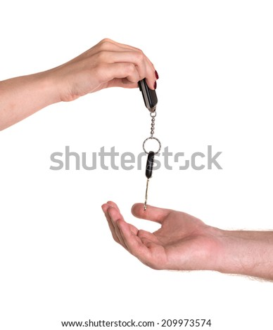 Woman giving car key to man on a white background