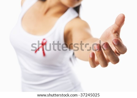 Woman giving her hand to give support for AIDS cause, using red ribbon badge on her chest. PS: you can change the ribbon color to pink for breast cancer support cause as both using the same symbol