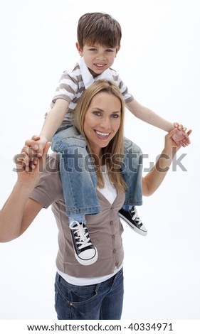 Woman giving little boy piggy back ride against white background - stock photo