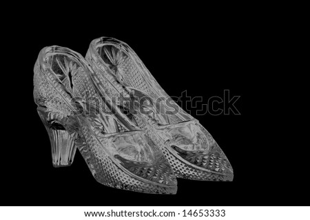 woman glass shoes isolated on black background - stock photo