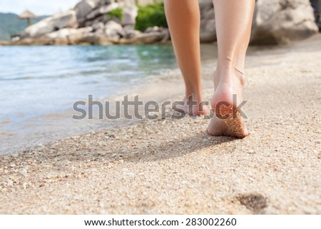 Woman going for a walk on the beach.  - stock photo