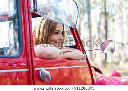 Woman going on a roadtrip in her convertible car