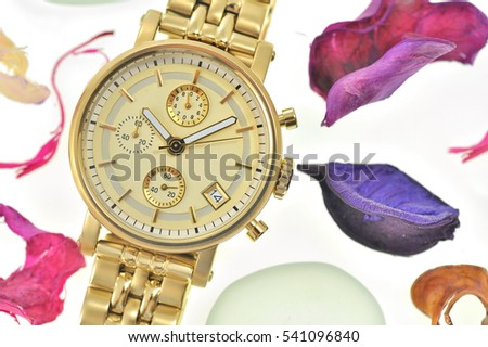 Woman gold wrist watch isolated
