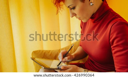 Woman graphic designer working with digital tablet pen. Illustrator girl using a digital pen on tablet. Drawing, painting, sketch, working, creative, graphic design, illustration. - stock photo