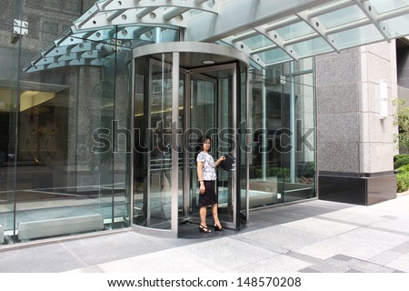Woman greeter welcomes people into a hotel - stock photo