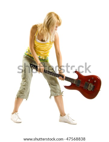 woman guitarist breaking her guitar  over white