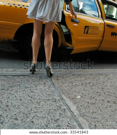 Woman hailing taxi - stock photo