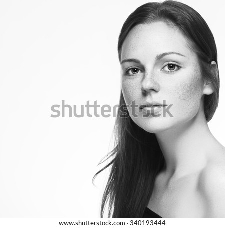 Woman half-face young beautiful freckles healthy skin portrait black and white - stock photo