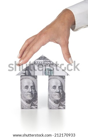 Woman hand and and dollar house