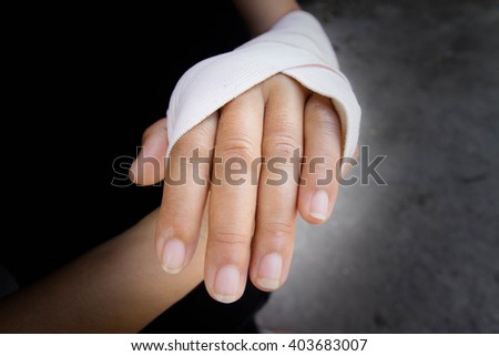 Woman hand and bandage,Pain of accident concept.