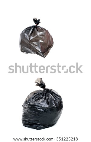 Woman hand carry garbage in plastic bag for eliminate on the white background - stock photo