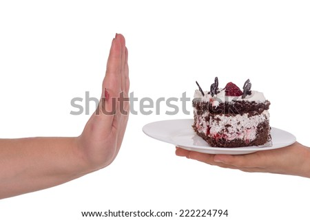 "Woman hand gesturing ""no"" to cake full of calorie, isolated on white - stock photo"