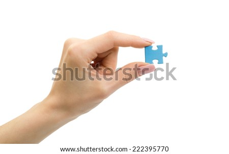Woman hand hold a puzzle. Creative concept. - stock photo