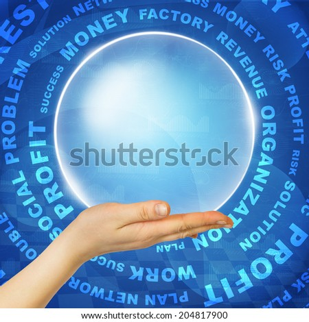 Woman hand hold glow circle against business words and graphs