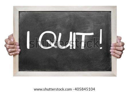 """Woman hand hold  """"i quit"""" write on dirty blackboard isolated on white background - stock photo"""