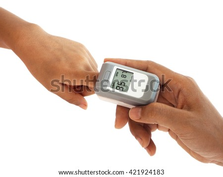 woman hand hold pulse oximeter for child used to measure pulse rate and oxygen levels , Patient with pulse oximeter on finger for monitoring