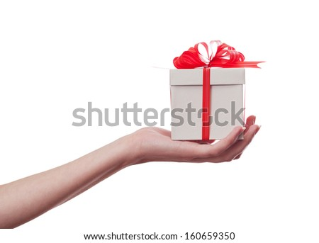 Woman hand holding a gift. With clipping path included. - stock photo