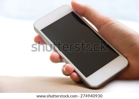 Woman hand holding a Smart Phone  - stock photo