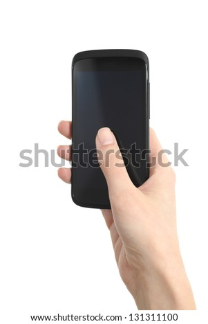 Woman hand holding and touching a mobile phone screen with her thumb on a white isolated background - stock photo