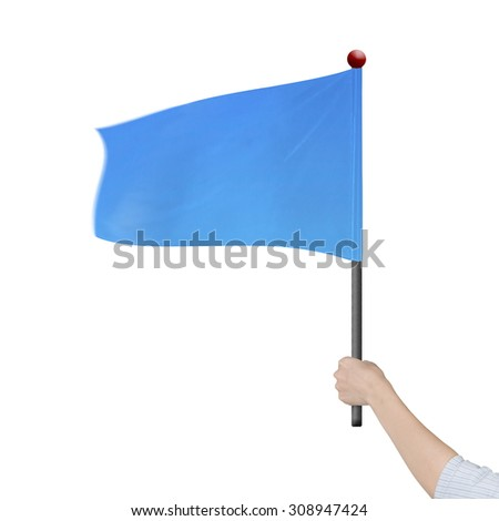 Woman hand holding blank blue flag, isolated on white background.