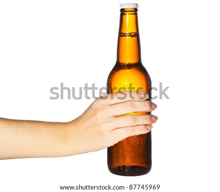 Woman hand holding bottle of beer