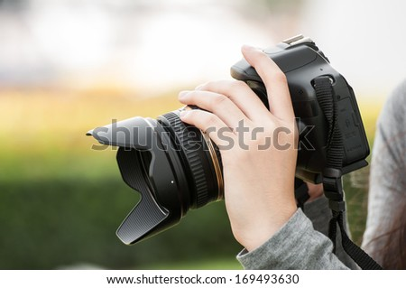 woman hand holding camera and preview picture. - stock photo