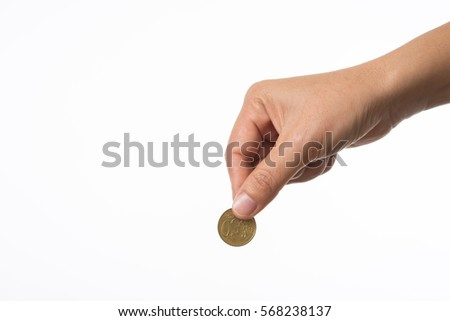 Woman hand holding coin to collecting.