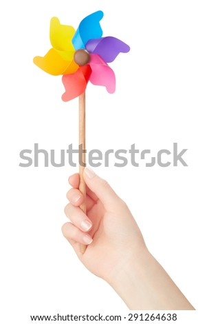 Woman hand holding colorful pinwheel isolated on white, clipping path included - stock photo