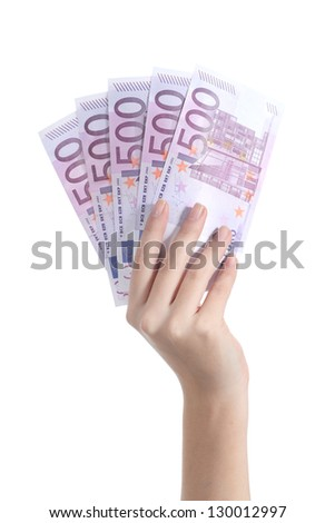 Woman hand holding five hundred euro banknotes on a white isolated background