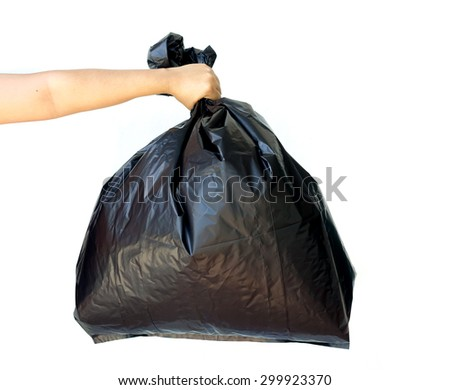 Woman hand holding garbage bag isolated on white background - stock photo