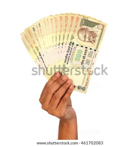 Woman hand holding Indian five hundred rupee notes