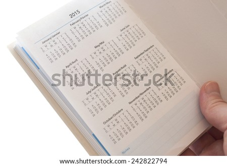Woman hand holding new calendar of 2015  - stock photo