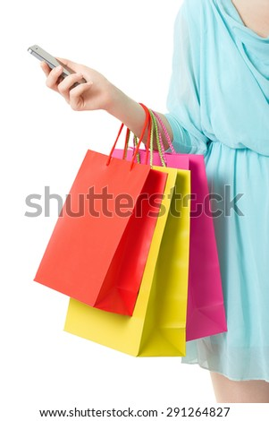 Woman hand holding shopping bags and smartphone on white, clipping path included