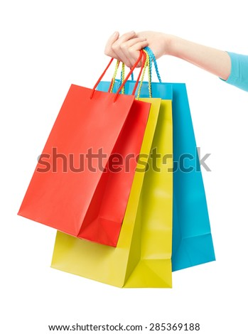 Woman hand holding shopping bags isolated on white, clipping path included - stock photo