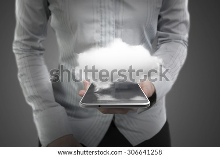 Woman hand holding smart phone of black touchscreen with white cloud, on dark gray background. - stock photo
