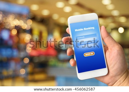 Woman hand holding smartphone against colorful bokeh abstract background mobile banking concept