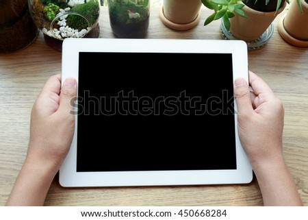 Woman hand holding tablet and watching screen concept - stock photo