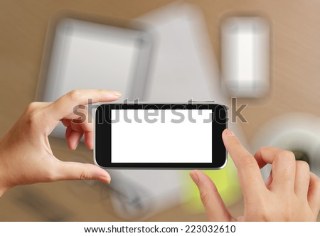 woman hand holding the phone tablet touch computer gadget as concept  - stock photo
