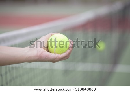 woman hand holding the tennis ball  - stock photo