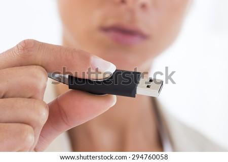 Woman hand holding USB Flash Drive  - stock photo