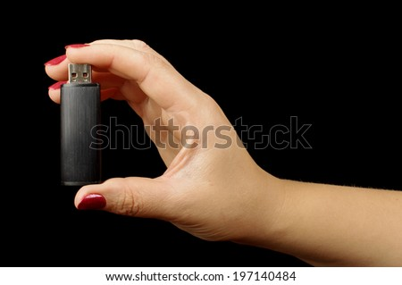 Woman hand holding USB flash memory stick - stock photo