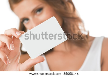 Woman hand holding white empty blank business card, shallow DOF, face in blur - stock photo