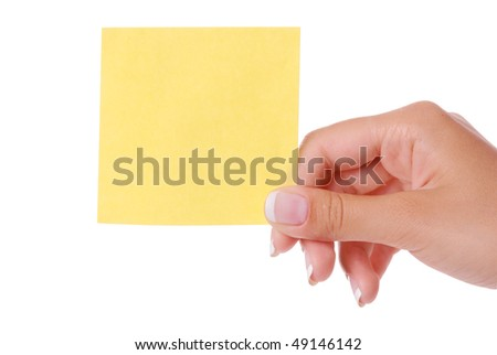 Woman hand holding yellow blank notepaper isolated on white background - stock photo