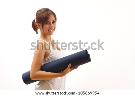 woman hand holding yoga mat for healthy fitness yoga workout - stock photo
