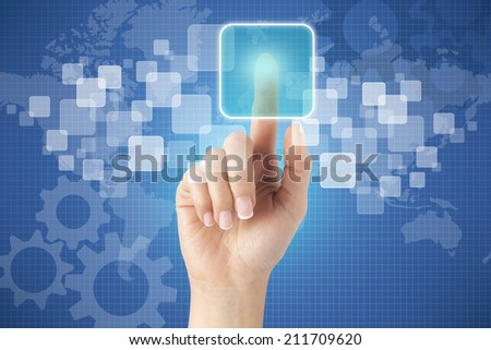 Woman hand in front of visual touch screen.