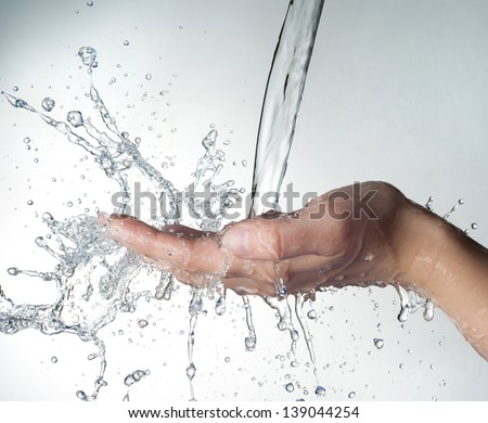 woman hand in water splash - stock photo
